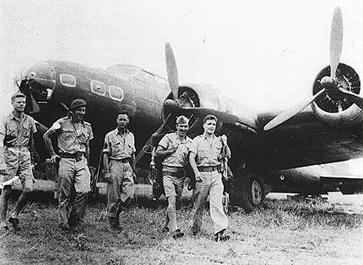 Lt. James T. Connally and the crew of B-17C Flying Fortress #40-2062 at Batchelor, Northern Territory after their first bombing raid out of Australia. Nine B-17's staged through Del Monte on Mindanao to bomb the Japanese landing at Legaspi.