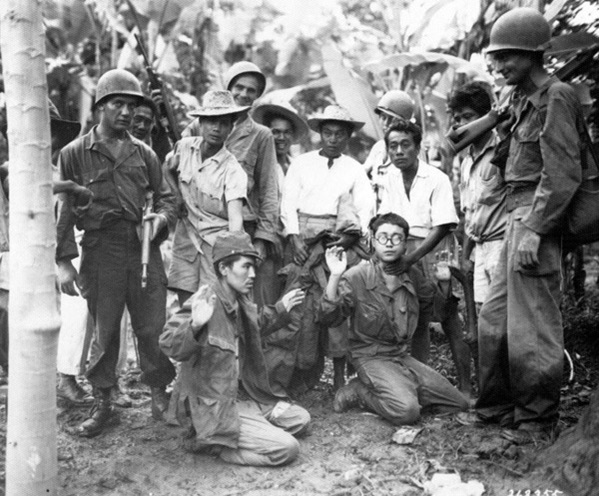 Allied forces show off a Japanese POWs. Filipino Guerillas and US Troops worked hand in hand (and oftentimes behind Japanese lines) while fighting on the Pacific island chain.